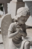 Praying angel statue Royalty Free Stock Photo