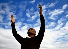 Praying with arms outstretched Royalty Free Stock Photo