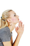 Praying beautiful woman. Isolated on a white background Stock Photos
