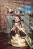 Praying beautiful woman in medieval dress Royalty Free Stock Images