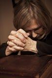 Praying on the Bible Royalty Free Stock Image