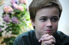 Praying boy. Praying teenager boy with folded hands Stock Photography