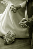 Praying bride and groom Stock Images