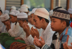 Praying In Brotherhood. The moslems pray at Moslem Dormitary in Bondowoso, East Java, Indonesia. The teenagers moslems of Indonesia learn about religion at that Royalty Free Stock Images
