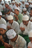 Praying In Brotherhood. The moslems pray at Moslem Dormitary in Bondowoso, East Java, Indonesia. The teenagers moslems of Indonesia learn about religion at that Royalty Free Stock Photography