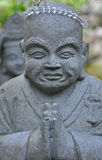 Praying Buddha with beads royalty free stock photography