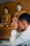 Praying for Buddha. MYAWADDY, MYANMAR - JAN 29, 2012 : Unidentified Myanmar man is praying for Buddha at the Shwe Myine Wan temple, Myawaddy, Myanmar on JANUARY Stock Image