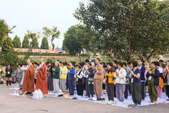 Praying buddhist believers Stock Image