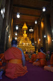 Praying buddhist monks Royalty Free Stock Photography