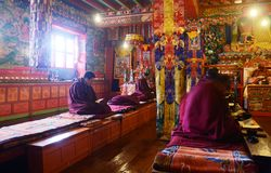 Praying buddhist Monks. In Tengboche Monastery (or Thyangboche Monastery), also known as Dawa Choling Gompa, located in the Tengboche village in Khumjung in Stock Image