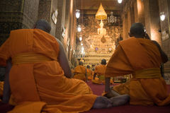 Praying buddhist monks Stock Photos