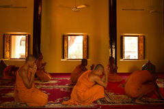 Praying Buddhist monks of Wat Damnak, Siem Reap, Cambodia Royalty Free Stock Image