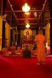 Praying Buddhist monks of Wat Damnak, Siem Reap, Cambodia Stock Images