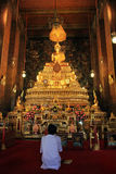 Praying at a buddhist temple Royalty Free Stock Image