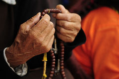Praying in Buddhist temple Stock Images