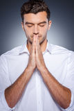 Praying for business. Stock Image