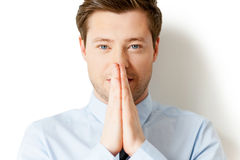 Praying for business. Royalty Free Stock Image