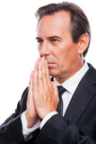 Praying for business success. Stock Photography