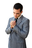 Praying businessman Stock Images