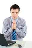 Praying businessman stock photo