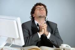 Praying businessman. Horizontal image of praying businessman Royalty Free Stock Photos