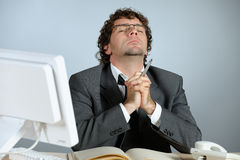 Praying businessman royalty free stock photos