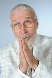 Praying businessman. Vertical image of praying senior businessman Royalty Free Stock Image
