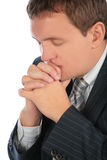 Praying businessman Royalty Free Stock Image