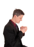 Praying businessman. Stock Photo
