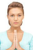Praying businesswoman stock photo