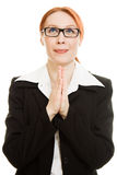 Praying businesswoman with suit Stock Image