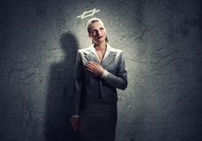 Praying businesswoman Stock Images