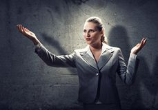 Praying businesswoman stock photography