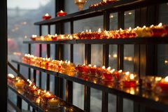 Praying candles peoples prayers for the person they love stock photo
