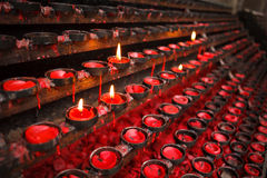 Praying candles Stock Images