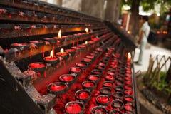 Praying candles Stock Photos