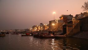 Praying ceremony by Ganges River in Varanasi India stock video footage