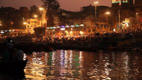 Praying ceremony by Ganges River in Varanasi, India stock video