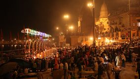 Praying ceremony by Ganges River in Varanasi, India stock footage