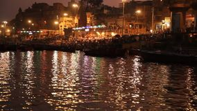 Praying ceremony by Ganges River in Varanasi, India stock video footage