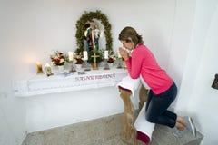 Praying in chapel Stock Photos