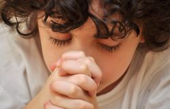Close Up of Hispanic Child Praying and Worshiping Royalty Free Stock Photo