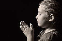 Praying child. stock photo