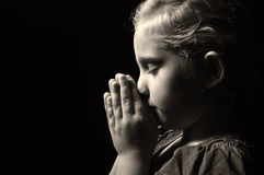 Praying child. Stock Image