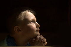 Praying child Stock Images
