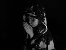 Praying child. Making a wish Stock Image