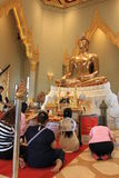 Praying at a chineese buddhist temple of Golden Buddha, Wat Traimit royalty free stock photography