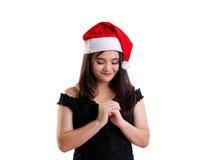 Praying Christmas girl isolated closeup royalty free stock photos