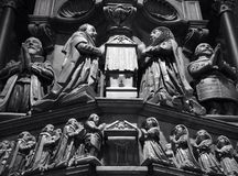 Praying. Church carving in cathedral, religious iconography, Church of England, Christian, black and Stock Image