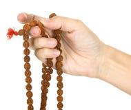 Praying com um rosário Fotos de Stock Royalty Free